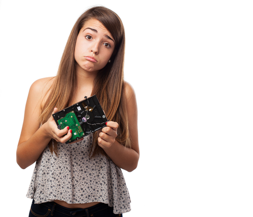 Girl holding broken hard drive